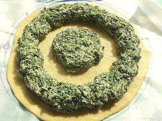 pastel de espinacas con forma de sol