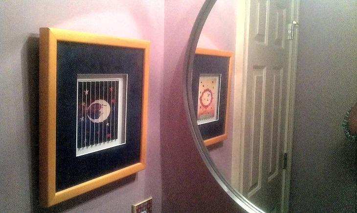 Ilusión óptica en un espejo