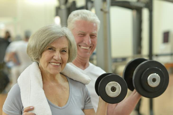 exercising at an older age woman and man at the gym