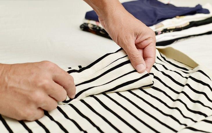 Cómo Doblar Tus Suéteres De Forma Adecuada