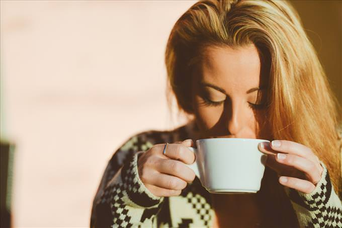 blonde woman sipping coffee